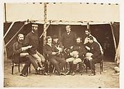 [Group Portrait: (L-R)Col.Yule P.W.D., Major Jones A.D.C., Mr. Walters, Captain Stanley A.D.C., Captain Baring A.D.C., Captain Roberts V.C.D.A.Q.M.G., Captain Hills V.C. A.D.C. and Sir E. Campbell Bart. Mry. Secry.]