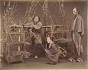 [Two Japanese Men and One Japanese Woman Posing with Flowering Branches]