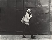 [Street Scene: Woman Wearing Straw Hat and Black Stockings, New York City]