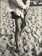 [Beach Scene: Man with Light Shirt and Dark Shorts, Coney Island, New York]