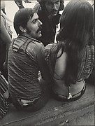[Street Scene: Two Mustachioed Men Conversing with a Woman, New York City]