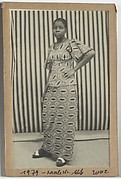 [Woman Standing Before Striped Background]