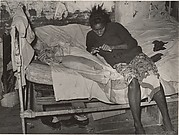 [African American Mother and Child on Bed in their Cabin near Jefferson, Texas]