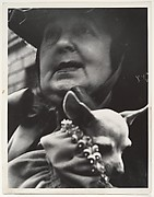 [Woman Holding Small Dog, possibly New York City]