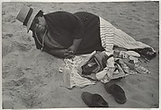 [Beach Scene: Woman Wearing Striped Hat and Dark Jacket, Coney Island, New York]