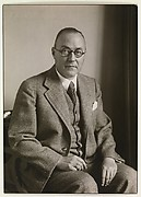 [Man Wearing Glasses in Three Piece Suit, Seated, Germany]