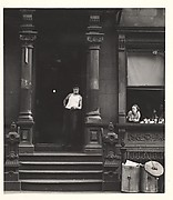 [Man in Undershirt Standing in Doorway, Woman Leaning on Window Sill, 406 West 25th Street, New York]