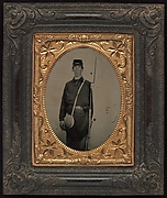 [Civil War Union Soldier with Rifle and Canteen, in Studio]