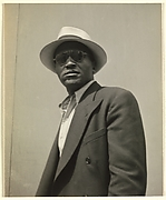 "[Male Pedestrian in Dark Jacket with Panama Hat, Detroit (for Fortune Magazine Article ""Labor Anonymous"")]"