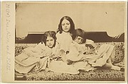 Edith, Ina and Alice Liddell on a Sofa