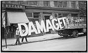 """[Workers Loading Neon """"Damaged"""" Sign into Truck, West Eleventh Street, New York City]"""