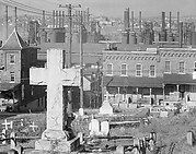 [View of Two-Family Houses and Steel Mill from St. Michael's Graveyard, with Cross Headstone in Foreground, Bethlehem, Pennsylvania]