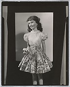 [Painted Plaster Figure of Girl in Floral Skirt]