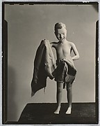 [Painted Plaster Figure of Boy on Beach with Towel]