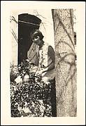[Georgette Maury Standing in Garden with Potted Plant, Les Cyprés de St. Jean par Grasse, France]