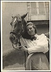 [Woman with Horse Standing Before Balcony]