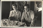 [Unidentified Man and Woman Seated at Table]