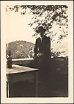 [André Maury with Hat, Cane, and Cigarette Leaning on Stone Wall, Cagnes, France]