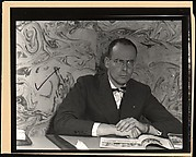 "[Lincoln Kirstein Seated Behind Desk, for Fortune Article ""The Boom in Ballet""]"