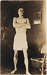 [Walker Evans with Cigarette in Mouth and Wearing Towel, in Fraternity House at Philips Academy at Andover, Massachusetts]