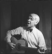 [72 Portraits of Carl Sandburg Singing and Playing Guitar]