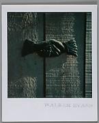 [Metal Door Placard of a Handshake]