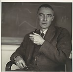 [Robert Oppenheimer Seated in Front of Blackboard]