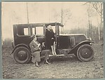 [John Gunther and Woman Seated on Sideboard of Car]