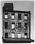 "[Façade of Brick Building with ""Peter W. Gibbons"" Sign]"