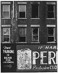 [Façade of Brick Building with Men's Clothing Advertisement]