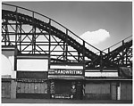 "[View of Rollercoaster Behind Booths with ""Handwriting"" Sign, Coney Island]"