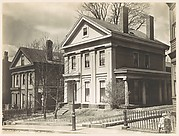 [Oblique View of Two Story House with Four Columns]