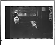 [Subway Passengers, New York City: Woman and Man]