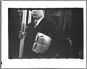 [Subway Passenger, New York City: Standee Carrying Parcel and Holding Pole]