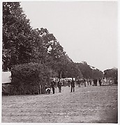 [Encampment alongside a stand of trees].  Brady album, p. 123
