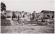 [Encampment with shacks and laundry].  Brady album, p. 129