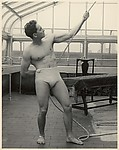 [Male Model Posed Pulling a Rope in Anna Huntington's Rooftop Studio]