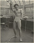 [Male Model Posed Pulling a Rope in Anna Huntington&amp;#39;s Rooftop Studio]