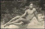 [Nude Male Model Posed on Driftwood at the Beach]
