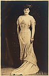 [Woman Standing in Evening Dress]