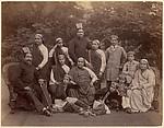 [Formal Family Portrait of Thirteen People, Men in European Dress]