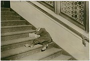 Newsboy asleep on stairs with papers, Jersey City, New Jersey