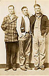 [Two Young Men Standing with Older Man]