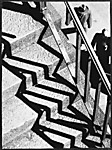 [Stairs, Railing, Shadows and Two Men]