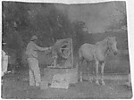 "[Eakins Modeling a Sculpture of ""Billy"" at Avondale]"