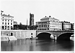 [View of the Pont au Change and the buildings on Place du Chtelet, with the Tour Saint-Jacques in the background]