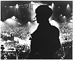 [Political Meeting, Darkly Silhouetted Man before Blurred Audience, Paris]