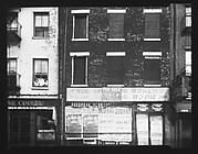 [Apartment Buildings with Ground Floor Posters, West Street, New York City]