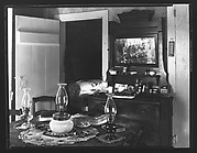 [Interior with Dressing Stand and Table with Three Kerosene Lamps, Possibly Copake, New York]