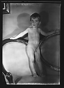 [Unidentified Naked Child Standing on Couch]